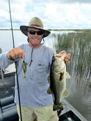 TV fishing show host Roland Martin shows off a nice bass caught on a recent trip to Lake Trafford.