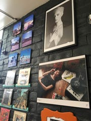 Photgraphy and classic vinyl line up the walls at Gré Coffeehouse & Art Gallery.