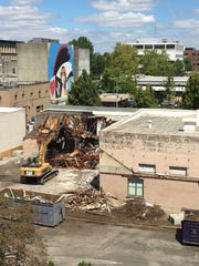 Demolition continues on the former Barrick Funeral Home building on Wednesday, Aug. 10, 2016, along Church Street SE in downtown Salem. After finalizing a lease with Starbucks in June, Wadsworth Development Group is demolishing the old funeral home to make way for a Starbucks drive-through, expected to open by December. Michael Day / Special to the Statesman Journal
