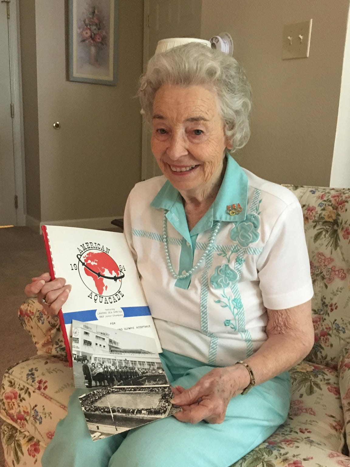 Frances Jones, 91, with some memorabilia from the 1964 world tour she took with the Lansing Sea Sprites.