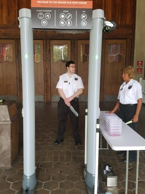 Security guards work at a new metal detector installed as part of increased security measures at the Grand Ole Opry House on Thursday.