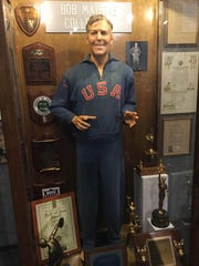 Above: Bob Mathias Olympic memorabilia on display at the Tulare Historical Museum Thursday, Aug. 18. Top: A mural in downtown Tulare showcases the town's Olympic heroes on Thursday, Aug. 18.