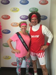 Celebrating 50 Fifty is a special milestone, and Johnna Louthan was feted by her employer Gill Orthodontics with a Sweating to the Oldies themed birthday party.   In the photo we see the birthday girl, Johnna and Dr. James Gill.