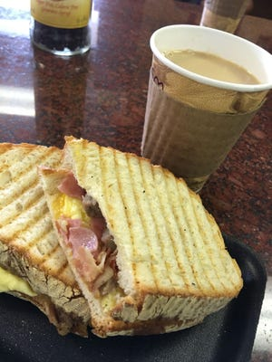 The breakfast panini at PSJ features perfectly scrambled eggs, melted cheese, cubes of sausage thin-sliced ham and bacon between big slices of a first-class, rustic-style Italian bread.