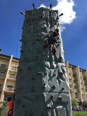 End-of-summer festivities at the Inn of the Mountain Gods Sunday included a challenging rock wall.