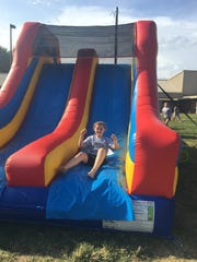 Tory Sola enjoying the bounce house during the event.
