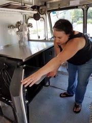 Karen Kahn Schultz shows off food prep and storage