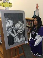 Mescalero Apache School junior Sharena Burgess calls