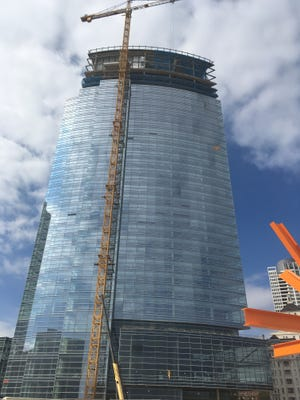 Milwaukee's Northwestern Mutual Life Insurance Co. said Thursday it plans to cut  about 100 jobs this year and hundreds more in 2017. The company current is building a new tower and commons near the lakefront.