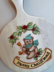 Christmas decorating is about to hit full swing after Halloween. This cute bear plaque might be just what you need for that special display this year.