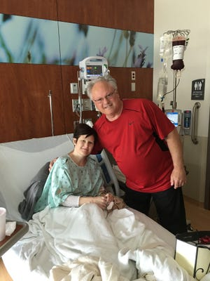 Renee Schulz-Stangl, left, and her brother, Brian Rasmussen, pose during Schulz-Stangl's transplant at Froedtert Hospital, Milwaukee.