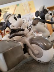 Jerry Stump loves Disney, and Clementine's carries an ever-rotating large selection of Disney figurines such as these of the lovable Mickey Mouse.