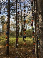 """Stringing Communities Together, created by art students from Groton, Homer, Cortland and Cincinnatus schools, hangs at Summerhill Sculpture Center."