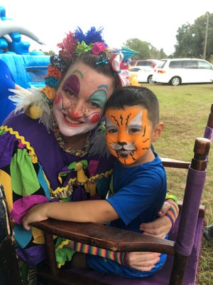 Fort Myers resident Sarah Able poses for a photo dressed as Joy the Clown as part of her called Kids Party Pals & Singing Telegram  business.