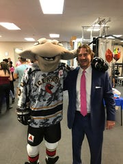 Dustin McArthur poses with the IceRays mascot during a meet and greet at Orthopedic Physical Therapy on Oct. 20.