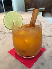 Masa will serve a jack-o-lantern margarita, made with a pumpkin puree, for $12 this weekend for its annual Dia de los Muertos celebration.