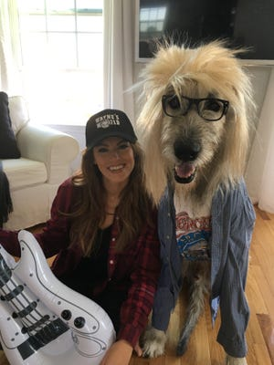 Former Miss Delaware USA and Smyrna resident Kate Banaszak and Kellan, her Irish Wolfhound, in the photo that made them internet famous.