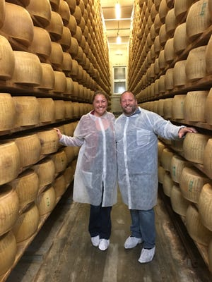 Volare Chef Josh Moore and his wife, Lindsay, at a Parmigiano-Reggiano cheese production facility in Italy.