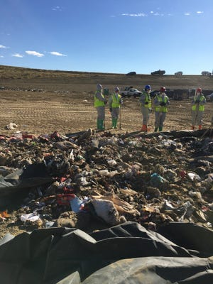 Recovery workers sort through refuse as they search for the body of a small boy believed to be buried at the North Weld Landfill near Ault, Nov. 2, 2016.