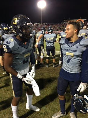 Gulf Breeze defensive backs Walter Yates III (left) and Matthew Demahy celebrate after  Yates' second interception in a win over Crestview. Yates and Demahy have combined for 14 interceptions this year.