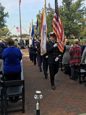 Sen. Lindsey Graham (back, center) watches as the military colors are retired at a Veteran's Day celebration at Greenville Memorial Hospital.