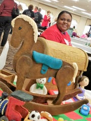 """Fronshea Hillman enjoys building with wood, so she created a montage of """"wooden"""" gingerbread toys including a rocking horse and toy chest."""