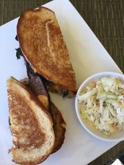 The espresso-ancho chili rubbed flat iron sandwich is a specialty on the menu at the Rusty Putter for $12.