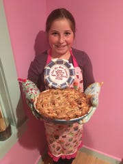 In her family's kitchen one recent afternoon after school, fifth grader Adelie Tebbetts recreates the apple pie that had earned her a blue ribbon at the local historical society's annual contest.