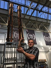 Valentine Distilling Co. owner and CEO Rifino Valentine describes how his distilling equipment works Aug. 10, 2016 at the distillery in Ferndale.