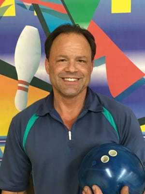Ron Floreani at Dixie Bowl after rolling an 816 series.