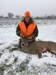Kris Schuh of Menchalville shows the six-pointer she shot at 7:15 a.m. opening morning. The buck stepped right into an opening she needed to make the shot.