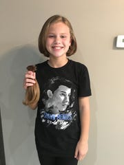 Greta McKee with her new haircut, and the locks she