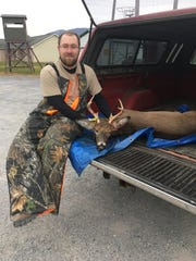 Dakota Stine, St. Thomas poses with his 8-point deer in the back of his truck.