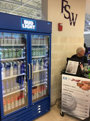 Florida SouthWestern State College is following national trends at college sports events selling beer and wine to the general public. A scene from Tuesday's program home openers at new, $28 million Suncoast Credit Union Arena.