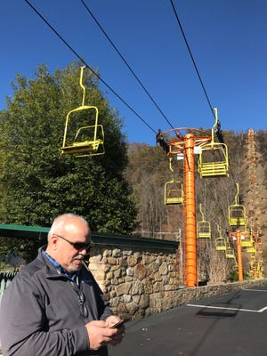Gary Bailey, GM of the Historic Gatlinburg Inn, helps assess damage at the iconic Sky Lift in downtown Gatlinburg on Friday, Dec. 2, 2016.