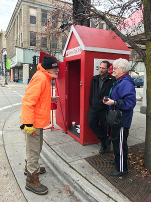 Salvation Army bell ringer Tom Drill chats with Salvation Army Business Development Director Kyle Bryntesen and Joyce Ayotte in downtown Manitowoc. The Christmas campaign fell $91,000 short this year, severely impacting the programs offered by Salvation Army.