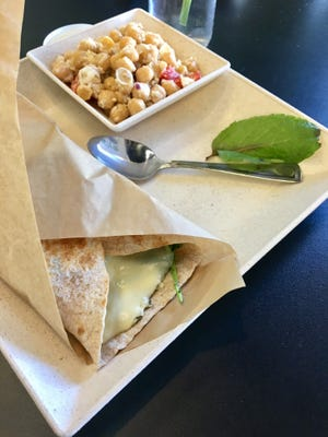 A wrap with chickpea salad from Living Vine Organic Cafe in Fort Myers.