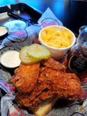 Deezie's hot chicken is... hot. And flavorful and delicious and addictive. It's perfect with a side of creamy macaroni and cheese and a bit of ranch or honey to tame the heat.