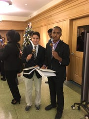 Tatnall Model UN members Ameen Belkadi and Chase Reid show off the gavels and certificates they received for winning Best Delegation during Salesianum's 30th DelMUN Conference.