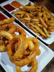 Can't decide between fries or onion rings as a side? Get both in table-size to share among friends. All the dipping sauces are made in house, even the ketchup.