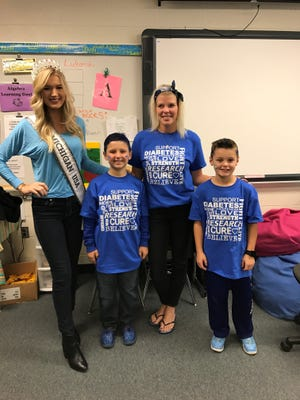 Miss Michigan Krista Fergusen, Dawn Mifsud, Drew Mifsud and Auben Wesley spoke at Blue Out.