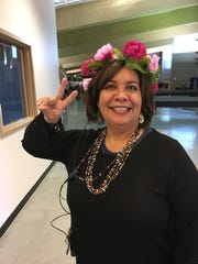 RMS Principal Anna Addis gets into the spirit of the school's One Book, One Community program. The book was Schooled, about a boy raised in a hippie commune.