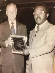 John Glenn accepts an award from the Rev. Robert S. Jordan Sr., a Chillicothe pastor who served on the board for the J. Ashburn Jr. Youth Center in Columbus' Hilltop neighborhood. Jordan's granddaughter brought this photo Friday when she went to the Statehouse to honor Glenn.