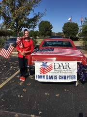 Jane Estes Tindol Weatherbee prepares to drive her red 1965 Rivera in the Veterans Day Parade on Nov. 12.