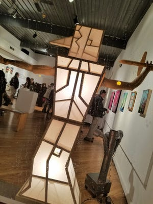Illuminated Man by University of Southern Indiana woodworking and sculpture instructor Robert Millard-Mendez took aim at guests entering the New Harmony Gallery of Contemporary Art.