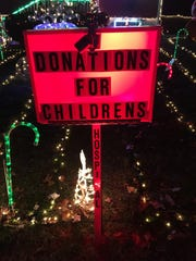 A donation box is illuminated in front of the Fishkill