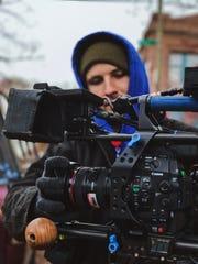 "Assistant camera operator Jake Huber prepares between takes on the set of ""Good Bones."""
