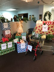 Elder Elf gifts wrapped and delivered by Carlton Fields employees/attorneys.