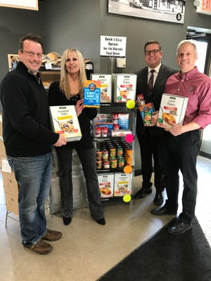The Kiwanis Club of Birmingham is holding a holiday food drive at Holiday Select Market in Birmingham. Pictured (left to right) are Dayne Haight, Tracy Katz, Brett Tillander from Boys & Girls Club and Tom Violante from Holiday Market Select.