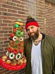 Matt Savage and a tower of doughnuts from Glaze Artisan